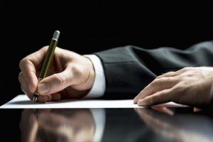 Businessman Writing A Letter Or Signing